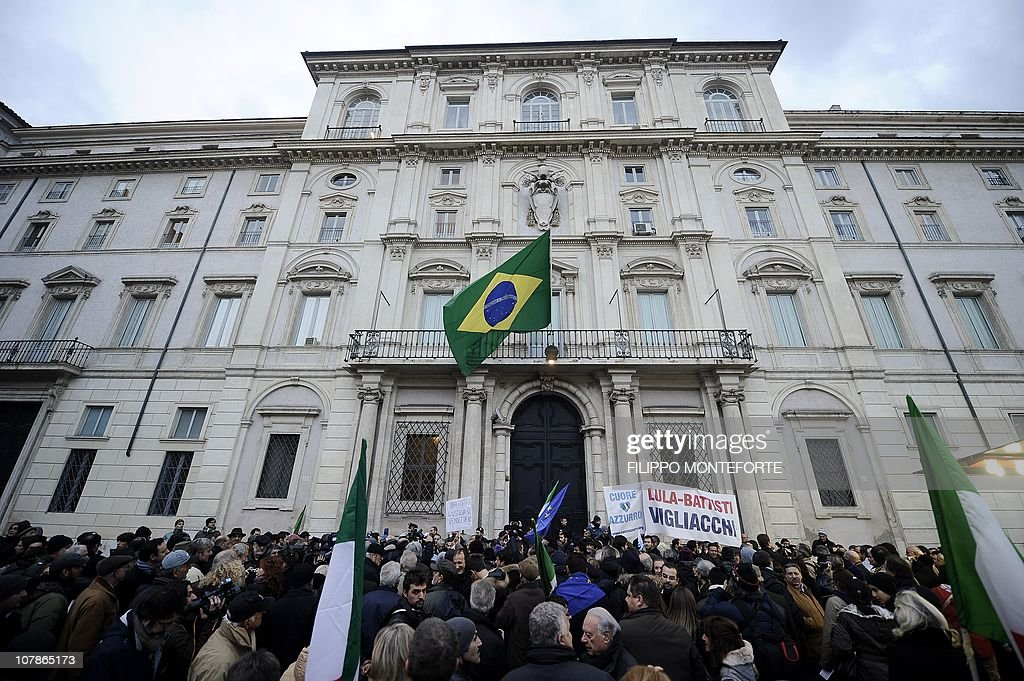 Demonstrators protest in front of Brazil's embassy (L) afgainst Brazilian President Lula's refusal to extradite ex-militant Cesare Battisti on January 4, 2011 at Piazza Navona in Rome. President Luiz Inacio Lula da Silva's refusal on December 31 to extradite Battisti, a member of the Armed Proletariat for Communism (PAC), a radical and armed left-wing group that killed several people in the 1970s, sparked a wave of indignation across Italy. Battisti has been found guilty of the group's 1978-1979 murders of a prison guard, a special investigator of terrorist organisations, a butcher and a jeweller, and in 1993 was sentenced in his absence to life in prison. AFP PHOTO / FILIPPO MONTEFORTE