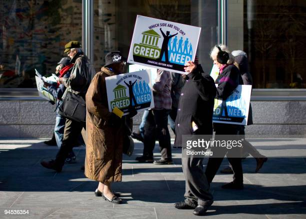 Demonstrators protest in front of Goldman Sachs Group Inc headquarters in New York US on Wednesday Dec 16 2009 Goldman Sachs should be probed for its...