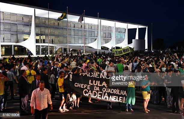 Demonstrators protest in front of Planalto Palace in Brasilia on March 16 2016 President Dilma Rousseff named her predecessor Luiz Inacio Lula da...