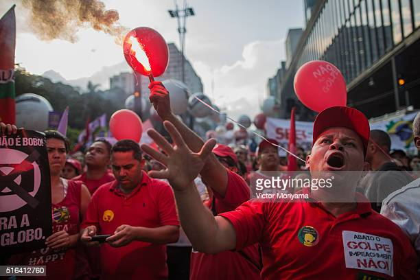 Demonstrators protest in support of former President Lula investigated for money laundering on March 18 in Sao Paulo Brazil Former President Luiz...