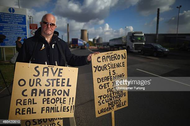 Demonstrators protest in support of the UK steel industry outside the Tata Steel processing plant at Scunthorpe after Tata announced job losses today...