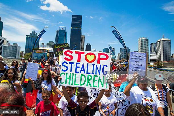 Demonstrators protest in the Brisbane CBD over indigenous land rights ahead of the G20 Leader's Summit on November 10 2014 in Brisbane Australia The...