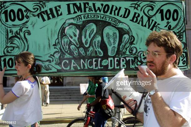 Demonstrators protest near the headquarters of the World Bank and International Monetary Fund April 29 2001 in Washington DC The IMF and World Bank...