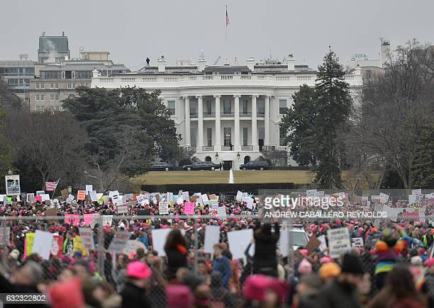 TOPSHOT Demonstrators protest near the White House in Washington DC for the Women's March on January 21 2017 Hundreds of thousands of protesters...