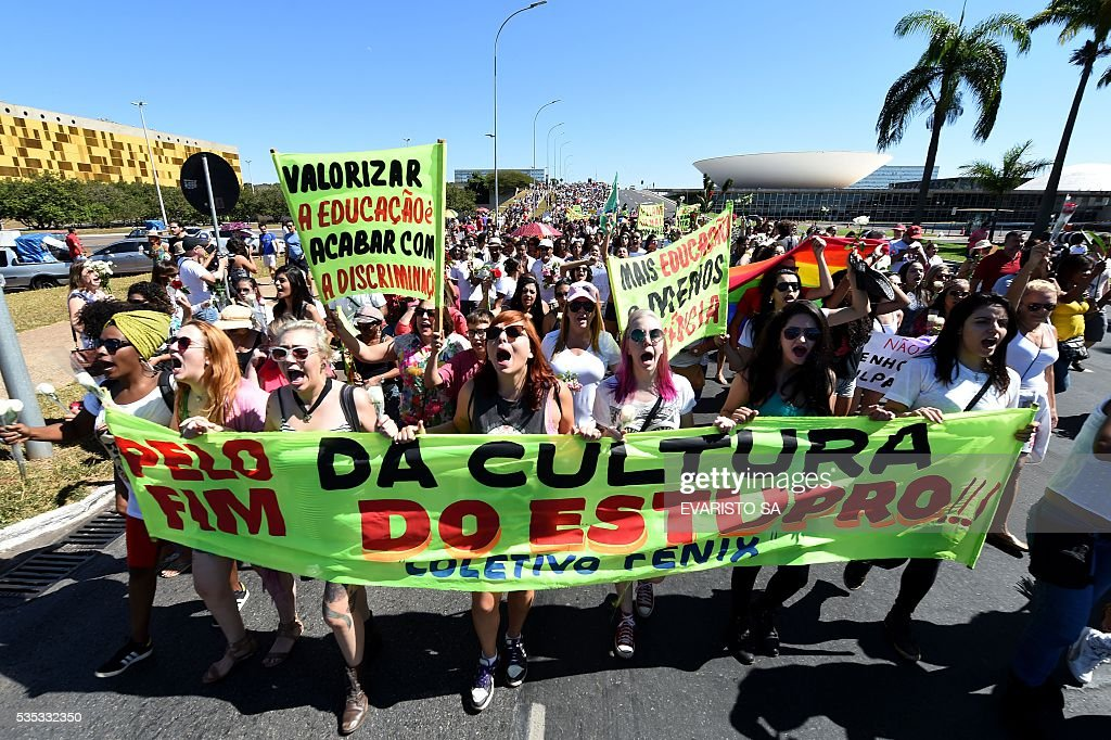 Demonstrators protest on the Esplanade of Ministries in Brasilia on May 29, 2016, against the recent gang-rape of a 16-year-old girl. Brazilian police are investigating the gang-rape of a 16-year-old girl, whose attackers posted an online video and photos that triggered global outrage, showing her naked on a bed and the alleged rapists bragging that she had been raped by more than 30 men. / AFP / EVARISTO SA
