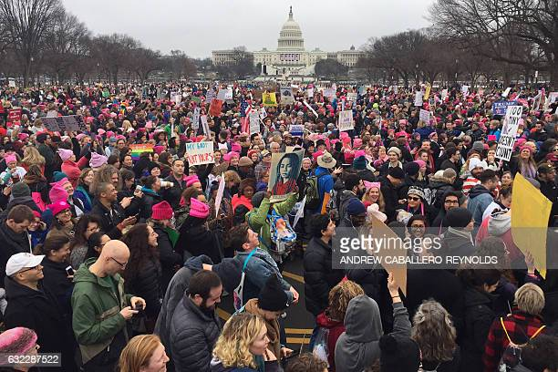 Demonstrators protest on the National Mall in Washington DC for the Women's march on January 21 2017 Hundreds of thousands of protesters spearheaded...