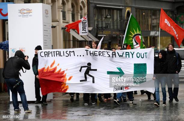 Demonstrators protest on the sidelines of the G20 Finance Ministers and Central Bank Governors Meeting in BadenBaden southern Germany on March 18...