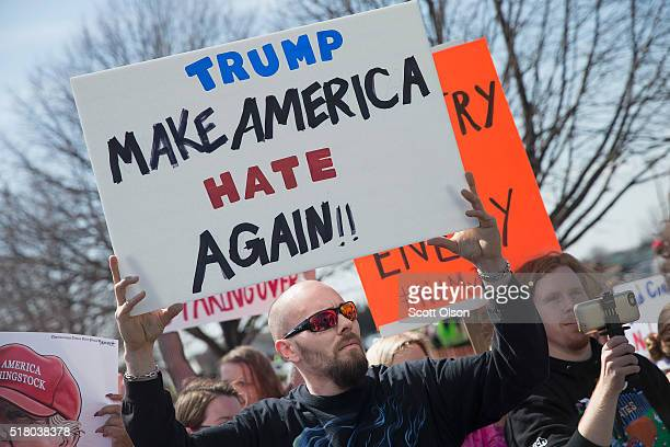 Demonstrators protest outside a campaign rally for Republican presidential candidate Donald Trump at the Holiday Inn Express hotel on March 29 2016...