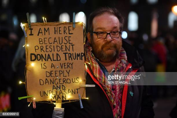 TOPSHOT Demonstrators protest outside Downing Street against US President Donald Trump in central London on January 30 2017 President Trump signed an...