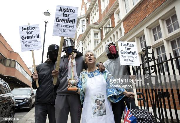 Demonstrators protest outside Kensington and Chelsea Town Hal west London England where members of the Council are to meet for the first time on July...