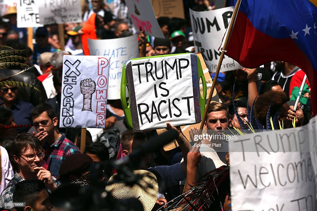Demonstrators protest outside of an arena where the presumptive Republican presidential candidate Donald Trump is holding a rally in San Diego on May 27, 2016 in Fresno, California. Trump is on a western campaign trip which saw stops in North Dakota and Montana yesterday and two more in California today.