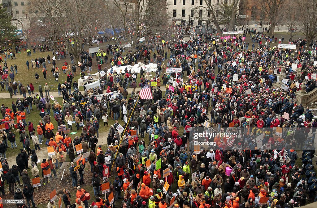 Demonstrators protest outside the Capitol building in Lansing, Michigan, U.S., on Tuesday, Dec. 11, 2012. Michigan lawmakers approved bills to prohibit mandatory union dues in workplaces as thousands of chanting protesters thronged the Capitol. Photographer: Jeff Kowalsky/Bloomberg via Getty Images