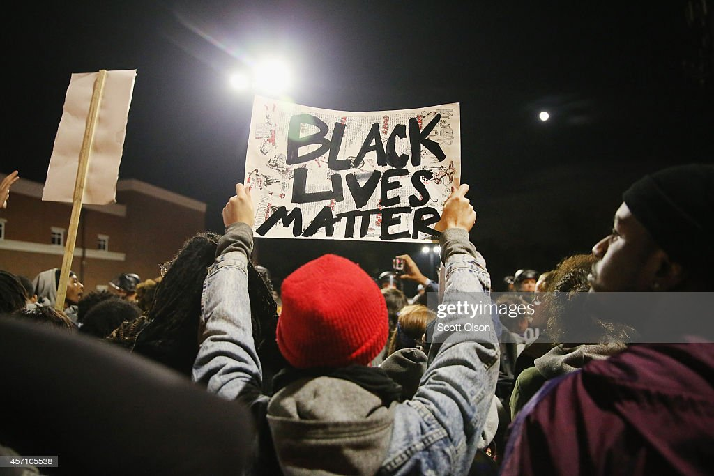 Demonstrators protest outside the Ferguson police department on October 11 2014 in Ferguson Missouri Ferguson has been plagued with protests which...