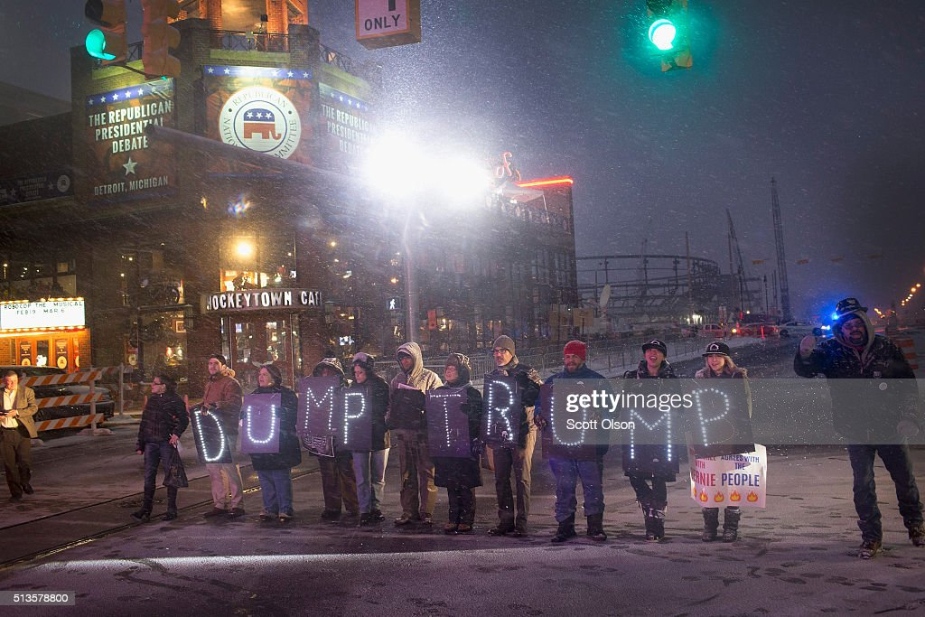 Demonstrators protest outside the Fox Theatre before the start of the Republican presidential debate sponsored by Fox News on March 3 2016 in Detroit...