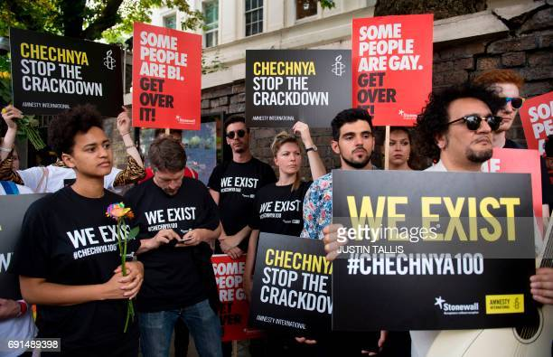Demonstrators protest over an alleged crackdown on gay men in Chechnya outside the Russian Embassy in London on June 2 2017 Russian Foreign Minister...