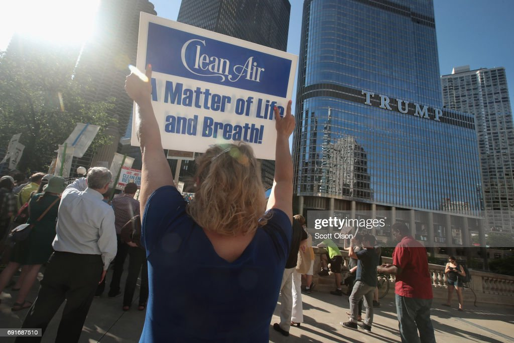Demonstrators protest President Donald Trump's decision to exit the Paris climate change accord on June 2, 2017 in Chicago, Illinois. Yesterday, in a speech from the Rose Garden, Trump announced that the United States would no longer honor the agreement, stating it imposed unfair standards on American businesses and workers.