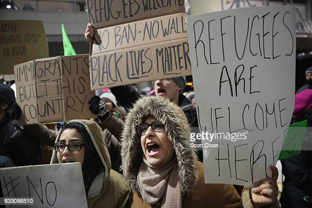 Demonstrators protest President Donald Trump's executive order which imposes a freeze on admitting refugees into the United States and a ban on...
