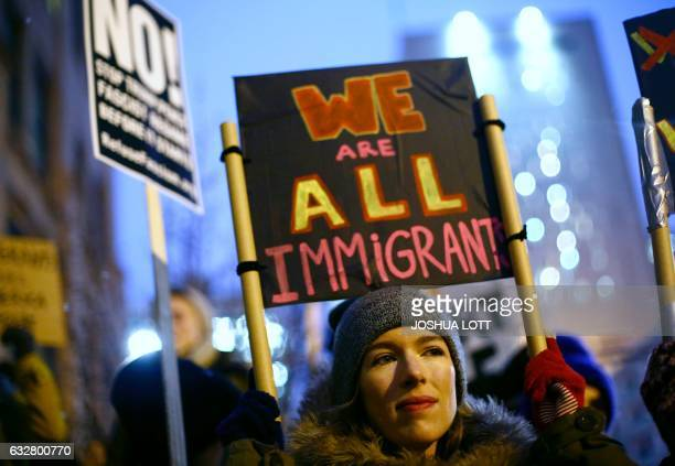 TOPSHOT Demonstrators protest President Donald Trump's plan to build a border wall along the United States and Mexico border on January 26 2017 in...