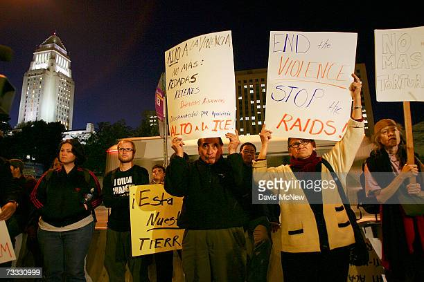 Demonstrators protest recent raids by agents with Immigration and Customs Enforcement who have apprehend illegal immigrants in southern metropolitan...