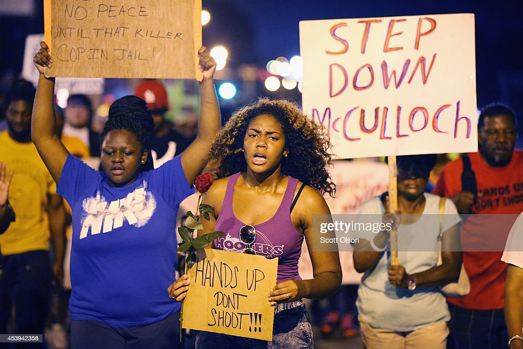 Demonstrators protest the death of Michael Brown on August 21, 2014 in Ferguson, Missouri. Brown was shot and killed by a Ferguson police officer on August 9. Despite the Brown family's continued call for peaceful demonstrations, violent protests have erupted nearly every night in Ferguson since his death.