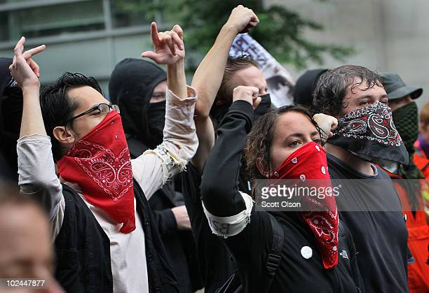 Demonstrators protest the G8/G20 summits June 26 2010 in Toronto Ontario Canada Store windows were smashed and a police car set on fire during the...