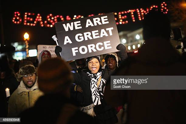 Demonstrators protest the shooting death of Michael Brown near the police station on November 21 2014 in Ferguson Missouri Brown an 18yearold black...