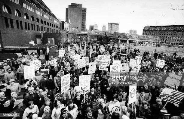Demonstrators protest the ticketing and booting practices of police at Faneuil Hall in Boston Feb 23 1982