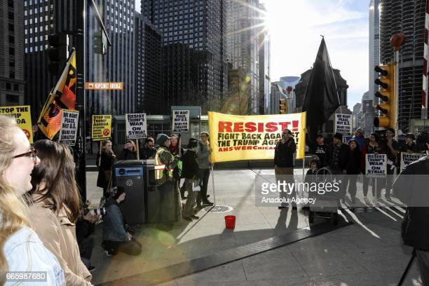 Demonstrators protest US military involvement in the Syrian war in Chicago United States on April 7 2017 The United States fired 59 Tomahawk missiles...