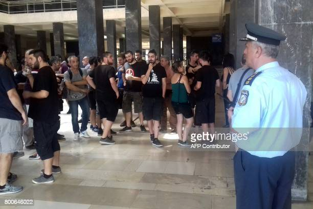 Demonstrators protesting against real estate auctions block the entrance to Thessaloniki's courthouse to notaries on June 21 2017 A tacit ban on...