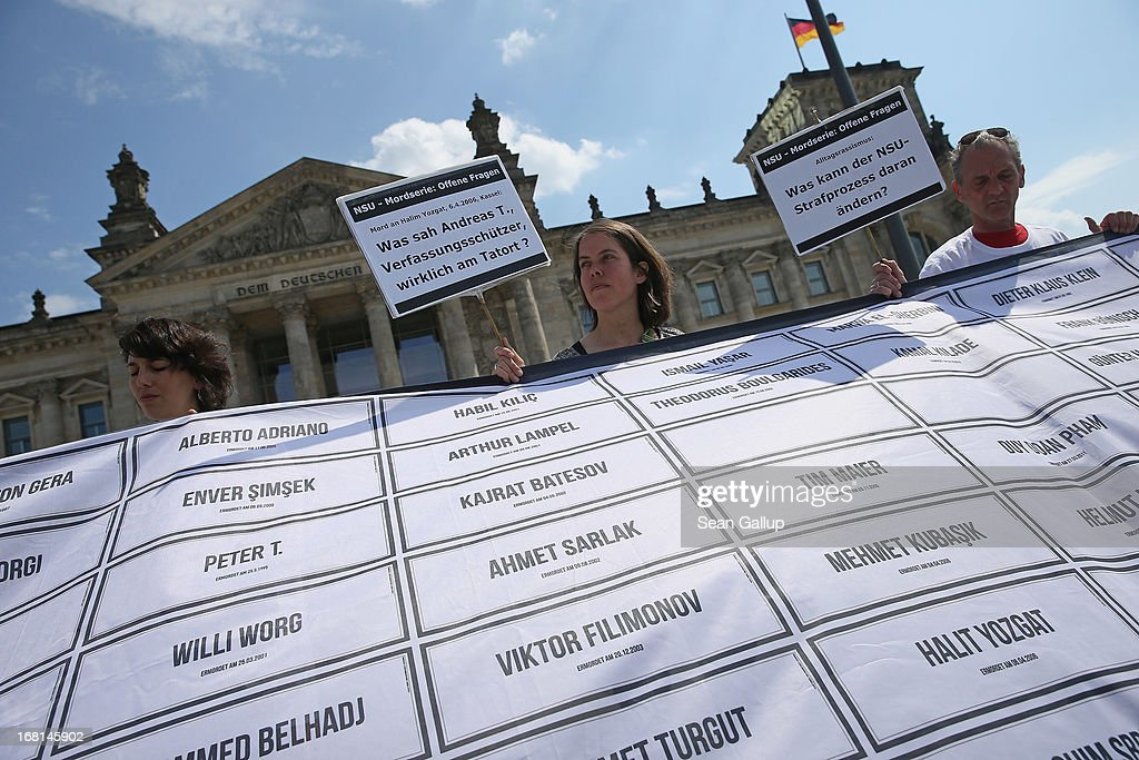 Demonstrators protesting against right-wing violence hold a banner with the names of murder victims of right-wing violence since 1989 in Germany, including NSU victims Halit Yozgat, Mehmet Kubasik and Enver Simsek, on the first day of the NSU neo-Nazi murder trial on May 6, 2013 in Berlin, Germany. The main defendant in the trial, which began today in Munich, Beate Zschaepe, is on trial for her role in assisting Uwe Boehnhardt and Uwe Mundlos in the murder of nine immigrants and one policewoman across Germany between 2000 and 2007, and four other co-defendants, including Ralf Wohlleben, Holder G., Carsten S. and Andre E., are accused of assisting the trio. Zschaepe, Mundlos and Boehnhardt lived together for years undetected by police and called themselves the National Socialist Underground, or NSU. The case only came to light after Mundlos and Boehnhardt committed suicide after the two were cornered by police following a bank robbery in 2011.