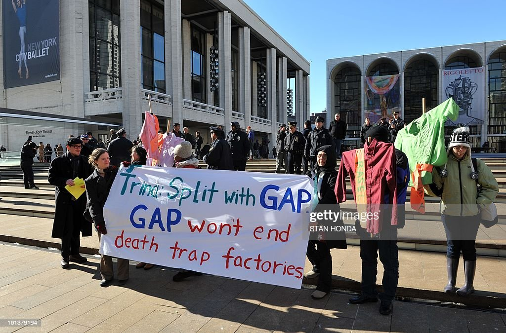 Demonstrators protesting conditions of garment workers outside the US on the sidewalk near the Mercedes-Benz Fashion Week Fall 2013 collections tent February 10, 2013 at Lincoln Center in New York. AFP PHOTO/Stan HONDA