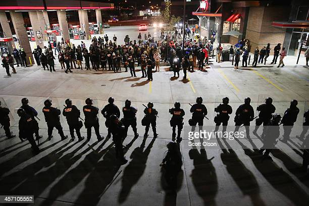 Demonstrators protesting the killings of 18yearolds Michael Brown by a Ferguson Missouri Police officer and Vonderrit Myers Jr by an off duty St...