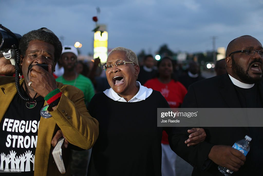 Demonstrators protesting the shooting death of Michael Brown make their voices heard on August 18, 2014 in Ferguson, Missouri. Protesters have been vocal asking for justice in the shooting death of Michael Brown by a Ferguson police officer on August 9th.