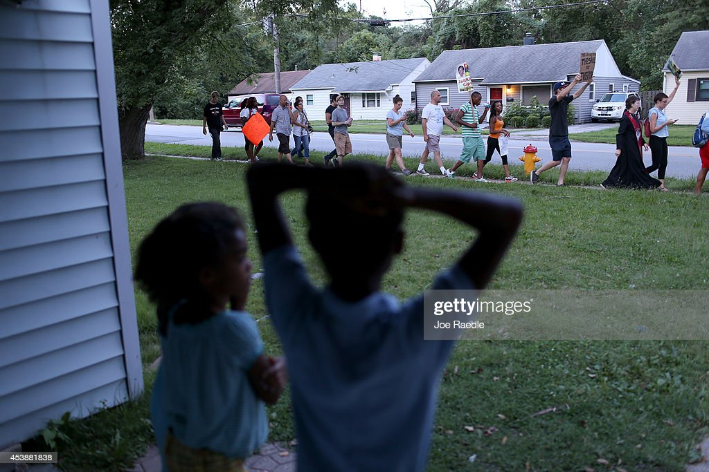 Demonstrators protesting the shooting death of Michael Brown march through the streets as they make their voices heard on August 20, 2014 in Ferguson, Missouri. Protesters have been vocal asking for justice in the shooting death of Michael Brown by a Ferguson police officer on August 9th.