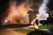Demonstrators protesting the shooting death of teenager Michael Brown flee as police shoot tear gas into the crowd of several hundred after someone...