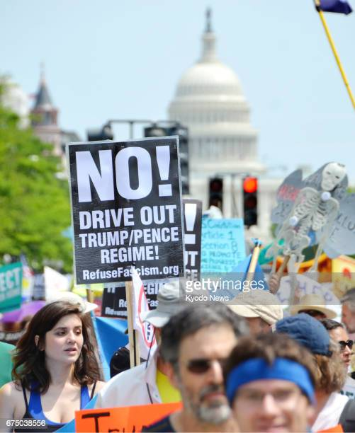 Demonstrators rally against the Trump administration in Washington on April 29 the 100th day of Donald Trump's presidency ==Kyodo