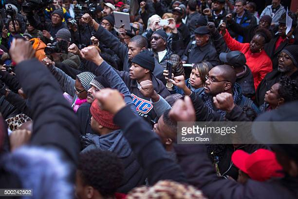 Demonstrators rally at the Thompson Center following a march through downtown to protest the death of Laquan McDonald and the alleged coverup that...