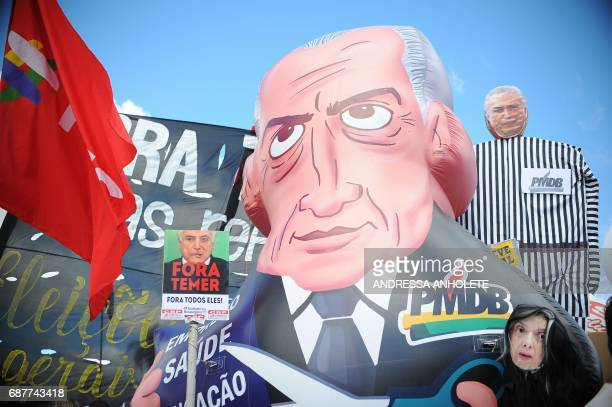 Demonstrators rally during the protest 'Occupy Brasilia' against the labor and social security reforms and the government of President Michel Temer...