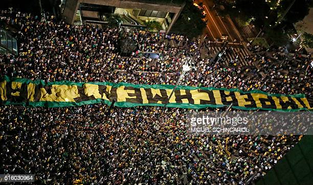 Demonstrators rally for Brazilian President Dilma Rousseff's impeachment along Paulista Avenue in Sao Paulo Brazil on March 16 2016 Rousseff named...