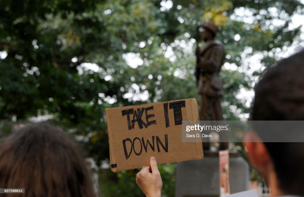 Demonstrators rally for the removal of a Confederate statue coined Silent Sam on the campus of the University of Chapel Hill on August 22, 2017 in Chapel Hill North Carolina.