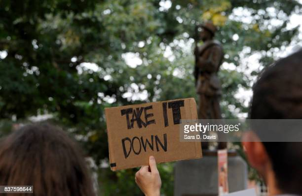 Demonstrators rally for the removal of a Confederate statue coined Silent Sam on the campus of the University of Chapel Hill on August 22 2017 in...