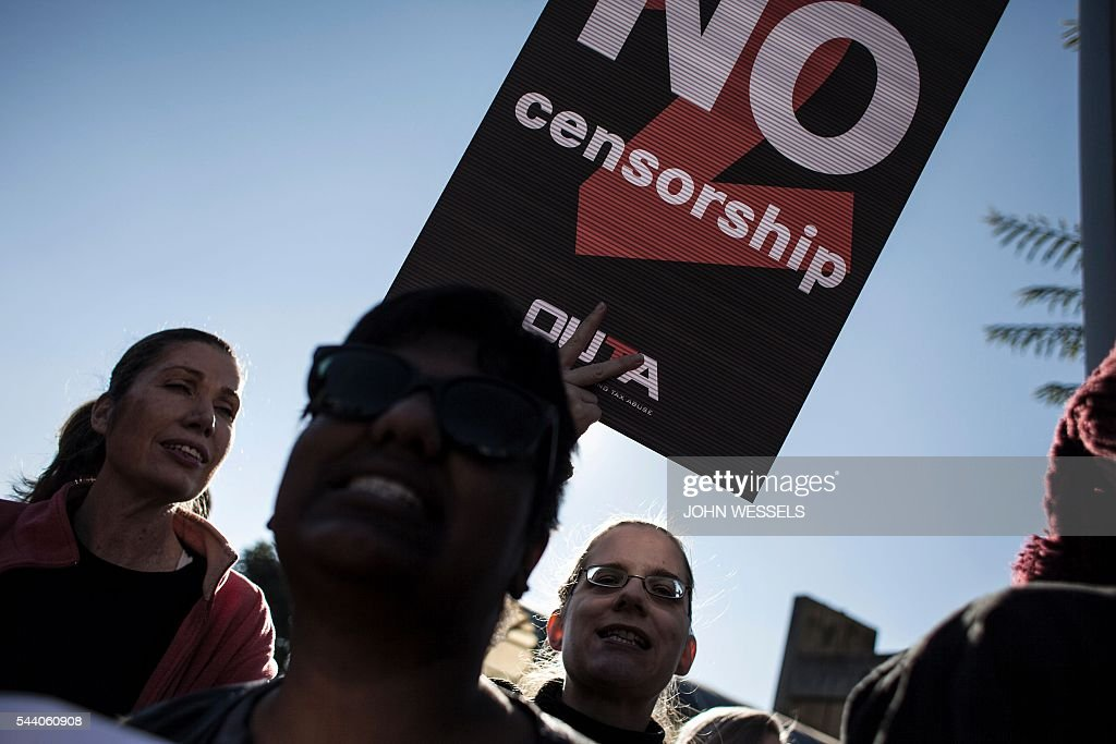 Demonstrators rally outside the offices of South Africa's public broadcaster on July 1, 2016 in Johannesburg to protest against alleged bias and self-censorship in news coverage ahead of key municipal elections. The South African Broadcasting Corporation (SABC), which is the primary news source for millions of people, has been accused of banning footage of violent protests, blocking opposition campaign adverts and avoiding criticism of President Jacob Zuma. / AFP / JOHN
