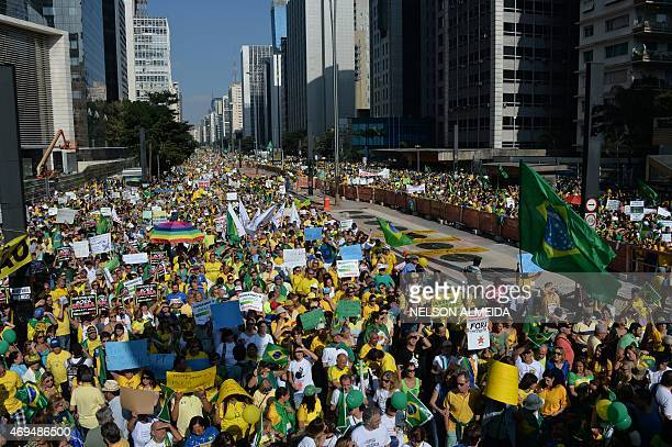 Demonstrators rally to protest against the government of Brazilian President Dilma Rousseff along Paulista Avenue in Sao Paulo Brazil on April 12...