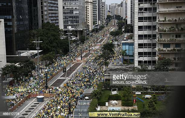 Demonstrators rally to protest against the government of president Dilma Rousseff in Paulista Avenue in Sao Paulo Brazil on 15 March 2015 Tens of...