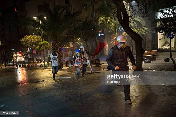 Demonstrators ran from police during clashes on February 25 2014 Thousands marched against corruption following the release of tapped phone...