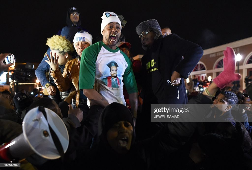 Demonstrators react after learning that the police officer who shot dead 18yearold Michael Brown will not face charge outside the police station in...