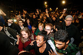 Demonstrators react as they were being push by by the police on Telegraph Ave during a demonstration over recent grand jury decisions in...