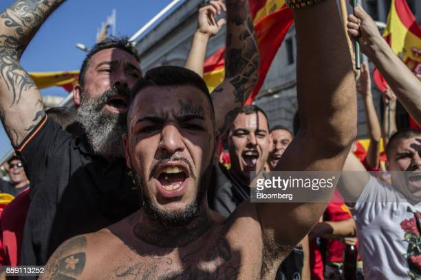 Demonstrators react during a protest for Spanish unity on the Marqus de la Argentera Avenue in Barcelona Spain on Sunday Oct 8 2017 Catalan business...