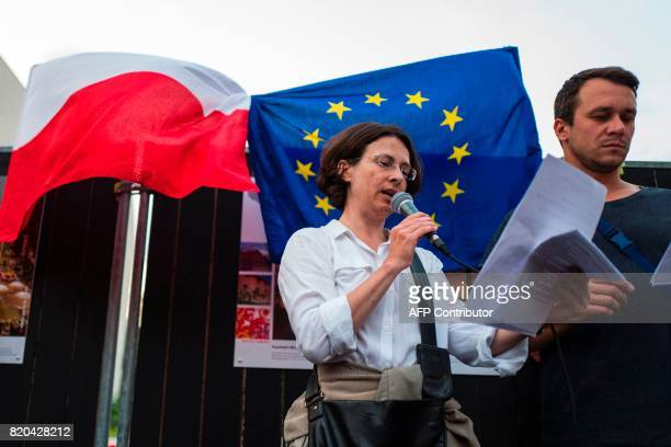 Demonstrators read excerpts of Poland's 1997 constitution during a candlelit vigil at the site of the Polish embassy in Berlin on July 21 2017 to...