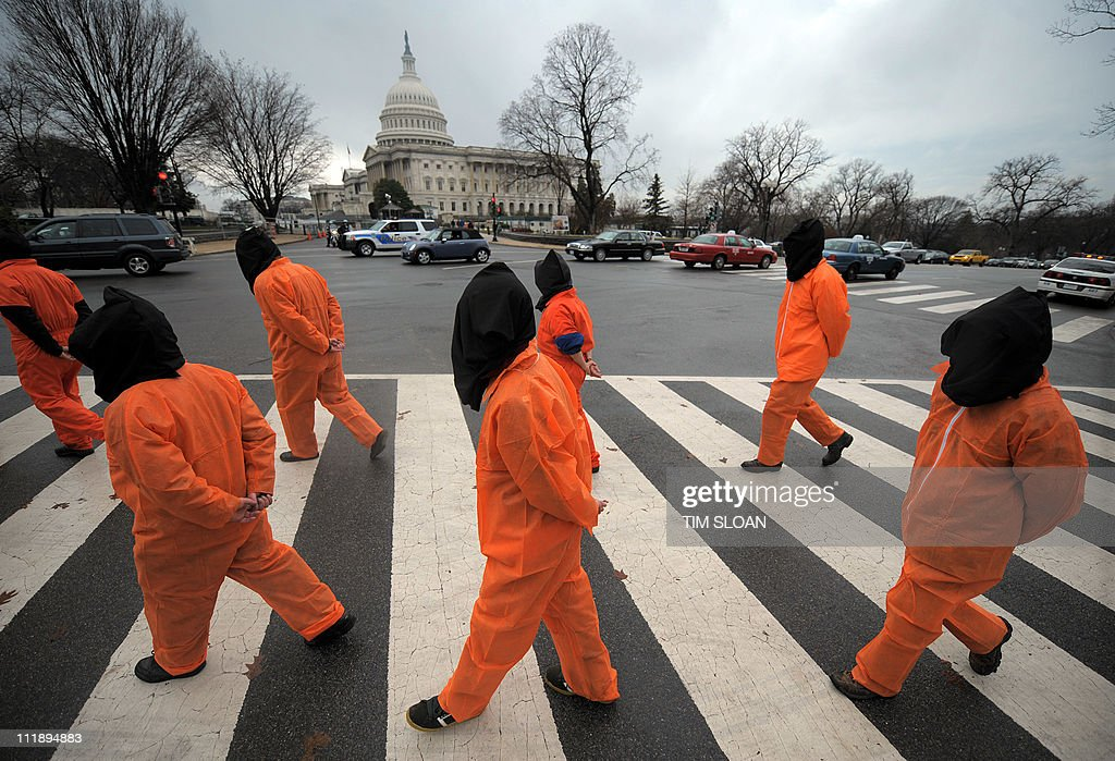 Demonstrators representing prisoners at the US Guantanamo Bay Naval Base walk during a rally against torture sponsored by Witness Against Torture with Amnesty International and the National Religious Campaign Against Torture 11 January 2008 on the National Mall in Washington, DC.